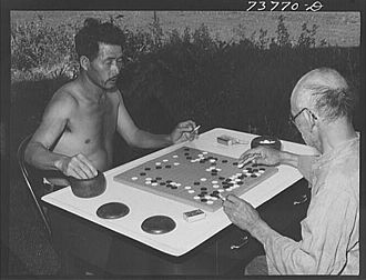History of Go - Japanese-American Farm Security Administration workers play go in Twin Falls, Idaho during the 1940s. Asian immigration to the U.S. was a factor in the growth of the game in the Americas.