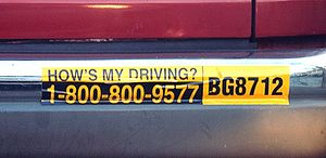 "Bumper sticker - ""How's my driving"" bumper stickers are often used on commercial vehicles so that employers can receive feedback about the driving habits of their employees."
