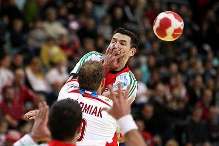 Ferenc Ilyés), hungarian Handball-Player, blocked with foul by Artur Siódmiak (Poland