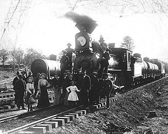 1901 in rail transport - Passengers and crew gather for a group photo on the first run of the Grand Canyon Railway.