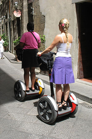 Dicycle - Two tourists on a Segway tour in Florence, Italy