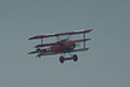 Fokker Dr.I Manfred Richthofen Flyby two 01 ThruDirtyWindow Dawn Patrol NMUSAF 26Sept09 (14576897806).jpg