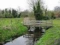 Footbridge crossing small stream - geograph.org.uk - 402356.jpg