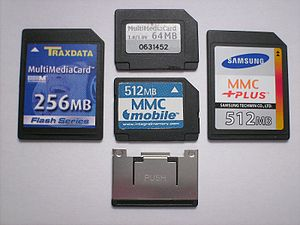 MultiMediaCard - Top of four types of MMC cards (clockwise from left): MMC, RS-MMC, MMCplus, MMCmobile, metal extender