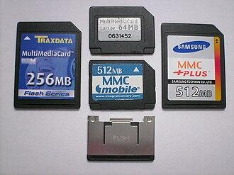 MultiMediaCard - Top of four types of MMC cards (clockwise from left): MMC, RS-MMC, MMCplus, MMCmobile, metal extender