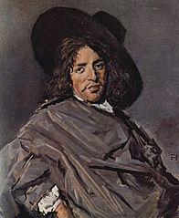 Portrait d'un homme assis avec un chapeau de travers