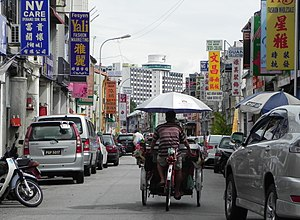 Cycling in Penang Island - A trishaw on the streets of George Town.