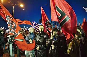 Golden Dawn (political party) - Golden Dawn members hold flags with the meander symbol at rally in Athens, March 2015