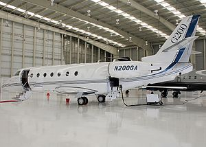 Gulfstream G200 - G200 in a hangar, access and luggage doors open