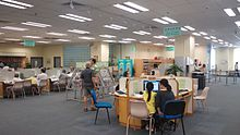 HK Shek Tong Tsui 石塘咀公共圖書館 STT Public Library interior July-2015 LG2 reading room n visitors.jpg