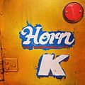 Hand painted Horn Ok signage on the wooden carriage space of a lorry in Bangalore.jpg