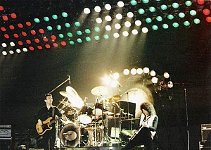 "Bohemian Rhapsody - From left to right: Deacon, Taylor and May in concert in Hanover in 1979. Behind the drum kit is the tam-tam used at the end of ""Bohemian Rhapsody""."