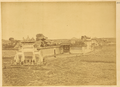 Hanzhong Fu, Major Tea Trading Market in Shaanxi Province. A White Marble Gateway (Pailou) outside a Walled Enclosure with an Elegant Tower. China, 1875 WDL2094.png