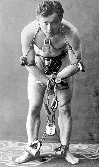 Escapology - Harry Houdini (1874–1926), a famous escapologist and magician