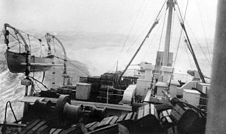 Kroonland pitches in heavy seas during a transatlantic crossing while in Navy service. Heavy seas aboard USS Kroonland, March 1919.jpg