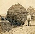 Herbert E. Fuller standing next to an Altamonte Hotel sign.jpg