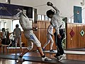 Hitting the head of an opponent in Épée fencing. Athenaikos Fencing Club.jpg