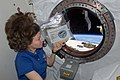 ISS-27 Cady Coleman holds a bag of space seeds.jpg