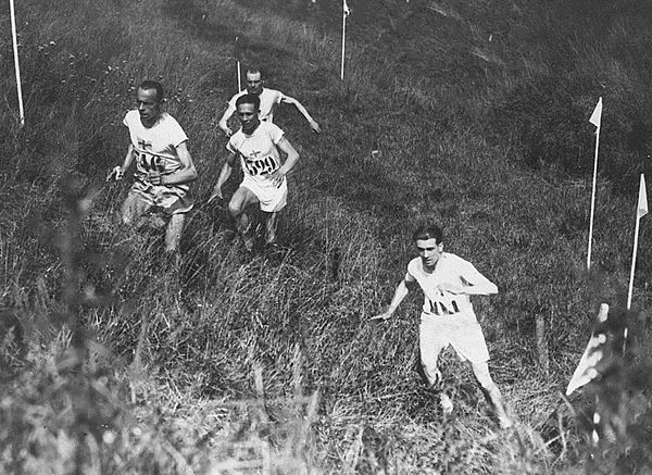 Individual cross country race at the 1924 Summer Olympics in Paris, France. The left trio is Edvin Wide, Ville Ritola and Paavo Nurmi. Due to the hot weather (over 40 degC (104 degF)) only 15 out of 38 competitors (elite long-distance runners) finished the race. Ind cross country 1924 Summer Olympics.jpg