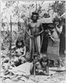 Indian family in Brazil posed in front of hut - 3 bare-breasted females, baby and man with bow and arrows LCCN2001705617.jpg