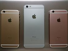 Reverse of three iPhones, showing the Apple logo
