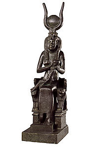 Isis with cow horns, solar disk, sitting on lion throne with Horus on her lap. (Egyptian Late Period)