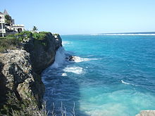 Photo of jagged cliffs beaten by strong surf and comprising eighty percent of the coastline inside Cobblers Reef.