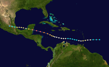 A map showing the path of a hurricane, with colored dots representing the storm's position at six-hour intervals, as well as its intensity based on a color scheme. The path begins at the right, moves generally to the left and crosses two land masses during that trek.