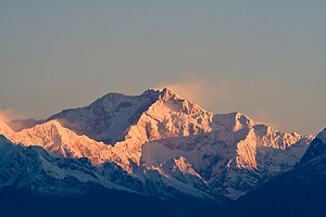 Morning sunlight hits the summit of Kangchenju...
