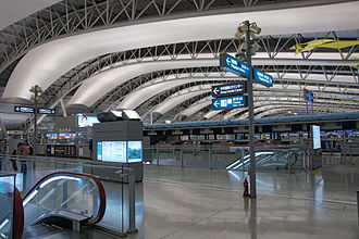 Kansai International Airport - 4th floor ticketing hall, illustrating the terminal's airfoil roof