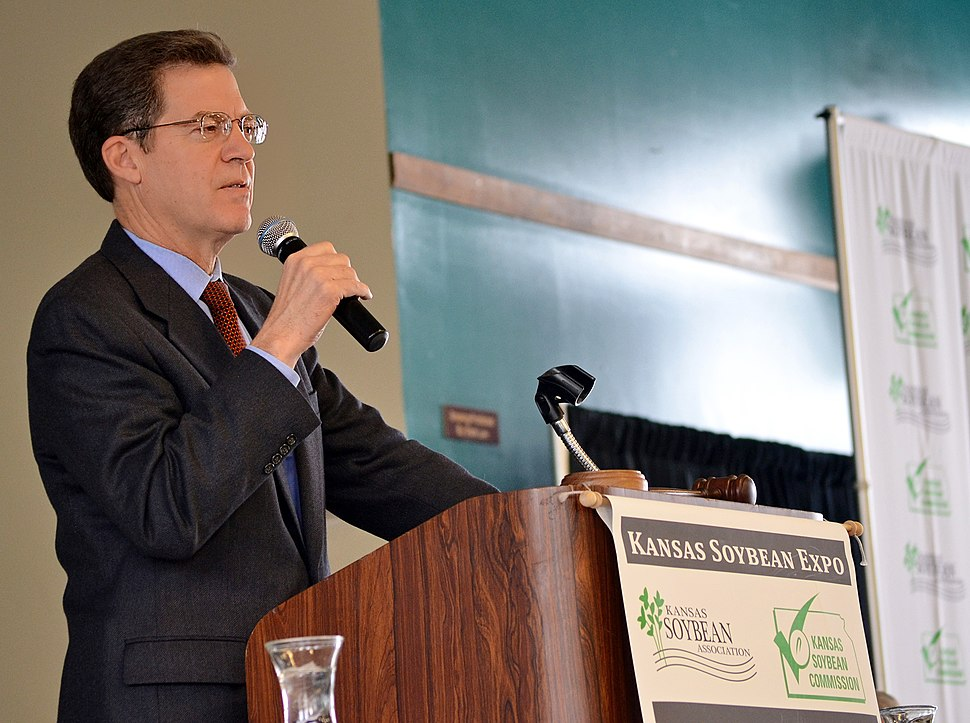 Kansas Governor Sam Brownback addresses during the Kansas Soybean Expo 2014
