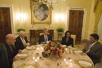 Foreign policy of the George W. Bush administration - President George W. Bush sits with Vice President Dick Cheney and Secretary of State Condoleezza Rice as they host a working dinner at the White House with President Hamid Karzai (left) of the Islamic Republic of Afghanistan, and President Pervez Musharraf, of the Islamic Republic of Pakistan, September 27, 2006. White House photo by Eric Draper.