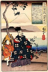 A woodcarving showing a man in a blue kimono looking up