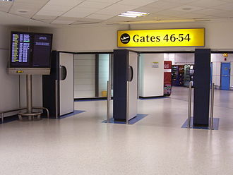 Expansion of Gatwick Airport - Gate area inside the North Terminal, showing flight information screens