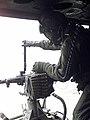 "Lance Corporal Kimberly Melton, USMC, a crewchief with Marine Light Attack Helicopter Squadron-267 (HMLA-267), prepares the Saco .50 cal M2 Machine Gun for firing from the UH-1N ""Hu - DPLA - 664a10ec83706639301708e95fdac50e.jpeg"