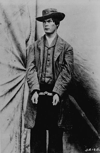 43rd Battalion, Virginia Cavalry - Mosby partisan Lewis Powell modeling for photographer Alexander Gardner the hat and overcoat he wore when he attacked William Seward April 1865.