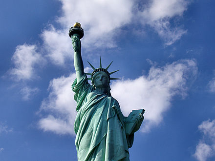 The Statue of Liberty in New York City, dedicated in 1886, is a symbol of the United States as well as its ideals of freedom, democracy, and justice Liberty-statue-from-below.jpg
