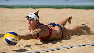 "Beach volleyball - Unlike indoor volleyball, beach volleyball is played on sand. Picture shows Liliana Fernández of Spain diving for a ""digging"" attempt."