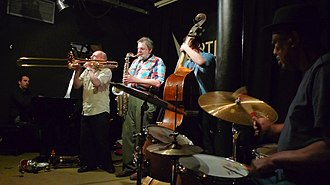 Jazz club - The Louis Moholo Quintet performing at a jazz club.