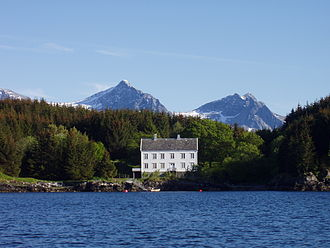 Dønna - The old trading house at Lauvøy, surrounded by Sitka spruce
