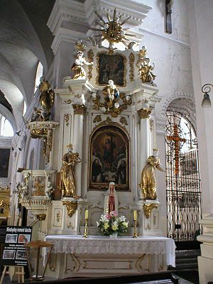 Feast of the Holy Name of Jesus - Altar of the Holy Name of Jesus, with the IHS monogram at the top, Lublin, Poland.