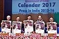 "M. Venkaiah Naidu releasing the Government of India Calendar-2017 with the theme ""Mera Desh Badal Raha Hai, Aage Badh Raha Hai"", in New Delhi.jpg"