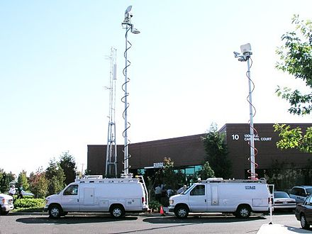 Microwave trucks seen transmitting. Modern news employs these trucks extensively. MSH04 news media trucks at CVO office 10-02-04 med.jpg