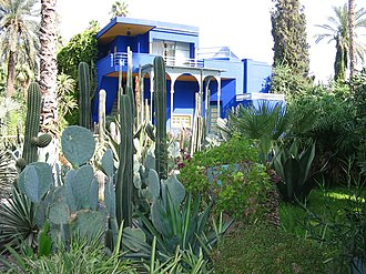 Majorelle Garden - Majorelle Garden's cactus collection, with Villa in the background