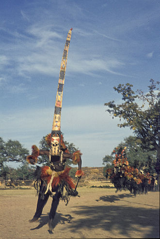 Dogon people - A man wearing a Sirige mask jumps during a ceremony, 1974