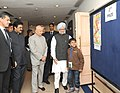 Manmohan Singh visiting the painting exhibition of National Painting Competition Prize winners, at the National Energy Conservation Day function, in New Delhi. The Union Power Minister (1).jpg