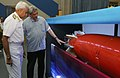 Manohar Parrikar and the Chief of Naval Staff, Admiral Sunil Lanba taking a close look at the 'Varunastra' torpedo, during the Handing Over Ceremony of 'Varunastra' torpedo to Indian Navy, in New Delhi.jpg