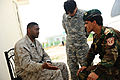 Marine Sgt. Nathan Brewer tries to reconcile a difference with an Afghan National Army soldier (4652540582).jpg