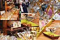 Market at Sarlat at all saturdays. This great tit steals also some nutcookies - panoramio.jpg