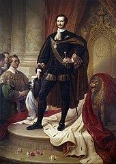 Un portrait de trois quarts d'un homme aux cheveux bruns en noir, or et cramoisi.  Il porte le médaillon et la chaîne de cou de l'ordre, fortement recouverts de bijoux.